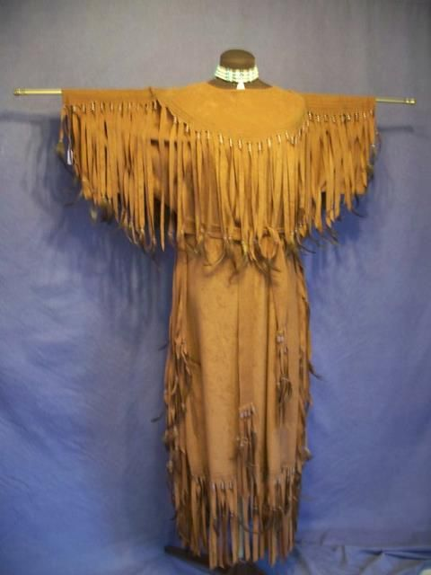 Deer Speaks Softly Designs - Native American Style Wedding Dresses. I think I would like this better in ivory/white with beads and feathers.