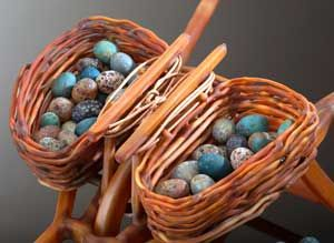 Contemporary art glass - hand blown glass wheelbarrow with woven glass baskets, filled with glass eggs.  Collaboration between Robert Mickelsen and Demetra Theofanous - available at Habatat Galleries Florida .