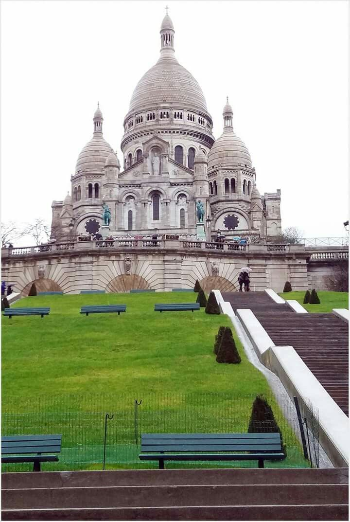 The Basilica of Sacré-Cœur, as seen from the base of the butte Montmartre. Plan for a morning trip to avoid crowd.