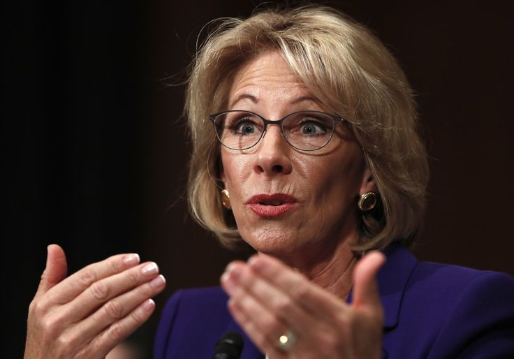 Progressives launch last-minute push against Betsy DeVos, and conservatives counter with online ad campaign