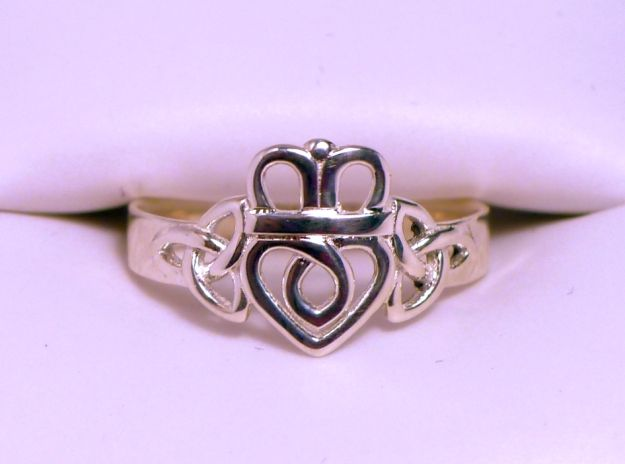 This is a 3D Printed Trinity Knot Claddagh Ring I designed. The heart is held by triquetra knots instead of hands. It is available in multiple sizes and materials.