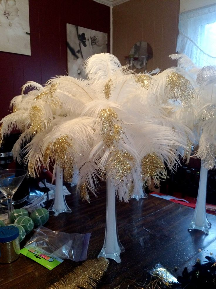 glitter tipped ostrich feather centerpiece in 16' eiffel vase by Vinci11 on Etsy https://www.etsy.com/listing/219255998/glitter-tipped-ostrich-feather
