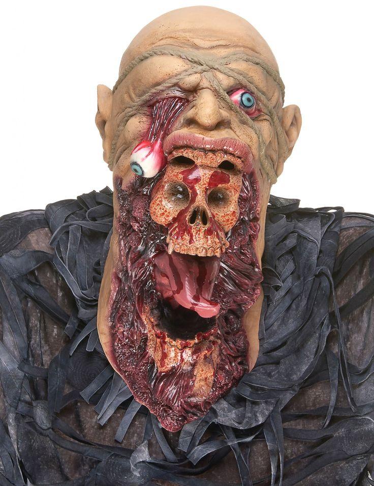 Masque latex zombie dévoreur adulte : Ce masque en latex pour adulte montre le visage tourmenté d'un homme zombifié. Le masque est intégral et des brillances sur les parties ensanglantées ne feront...