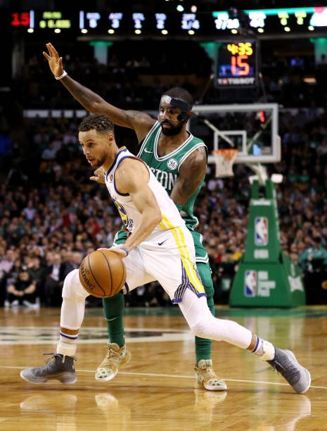 Kyrie Irving of the Boston Celtics defends Stephen Curry of the Golden State Warriors during the first quarter at TD Garden on November 16 2017 in...