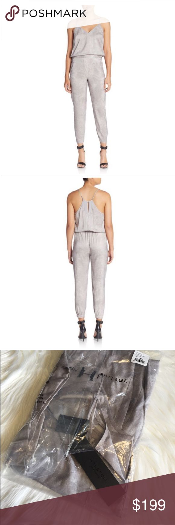 """Halston Heritage Spaghetti Strap Gray Jumpsuit Halston Heritage Gray Pants Jumpsuit Size 10 Color: Mist Paint •Luminous painted print casts a metallic effect on this chic jumpsuit •V-neck •Adjustable spaghetti straps •Banded waist with button tabs •Side slant pockets •Elasticized hems and back waist •Racerback keyhole with button closure •About 56"""" from shoulder to hem •Inseam, about 26"""" •Polyester/spandex •Machine wash or dry clean •Imported •Model shown is 5'10"""" (177cm) wearing US size 4…"""