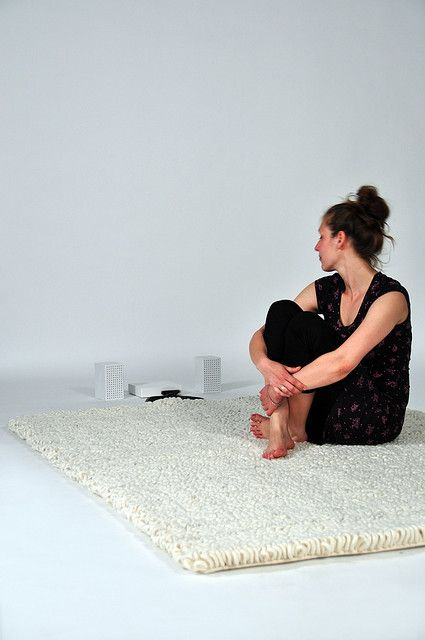 Human Antenna by kraeutli.com, via Flickr - A carpet made of loops from conductive thread.  By standing on it, your body acts as an antenna. The carpet picks up the radio waves, which your body receives and makes them hearable. When walking on the carpet you can tune it to a certain frequency, like the tuner of a radio.