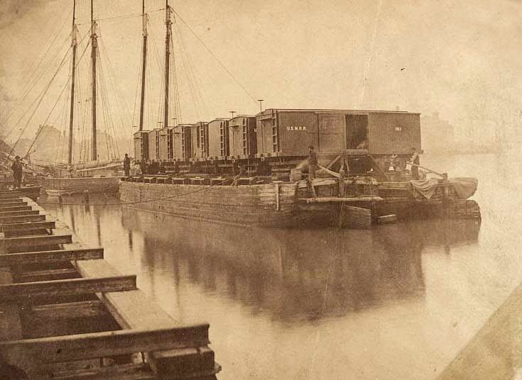 This picture is from the Civil War, and shows a rather unique mode of transportation . . . box cars carried by pontoon boats. I am not sure what necessitated this mode of transport, but I would think loading and unloading the cars on and off the pontoons would be tedious.