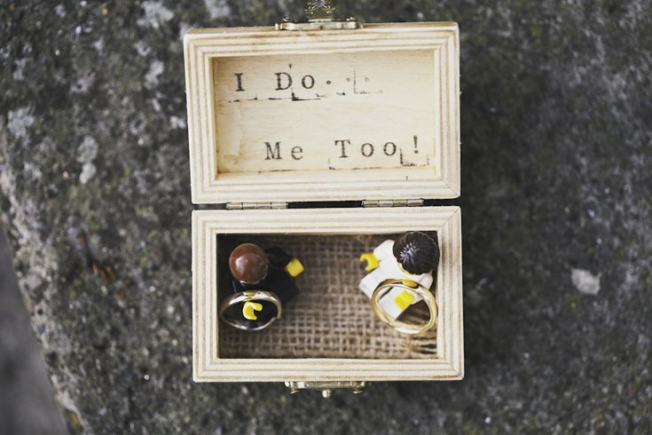 Super cute wedding ring box with lego couple holding onto the rings