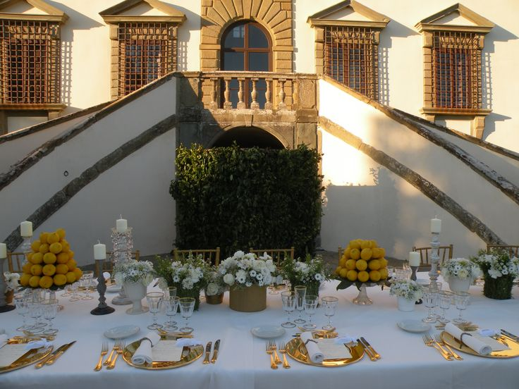 Vintage table settings in front of the  Tuscan Villa  www.guidilenci.com