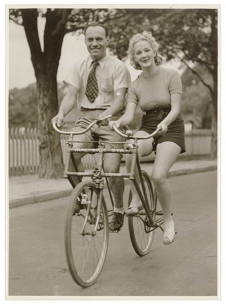 Man and woman on a Malvern Star abreast tandem bicycle, c. 1930s, by Sam Hood (Australia)