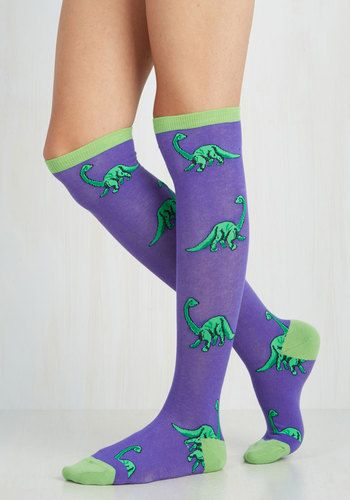 The colossal coolness of these patterned socks are sure to stand the test of time - just like your style! These indigo knee highs flaunt a lime green contrast and matching dinosaurs that are bound to make 'prehistory'.