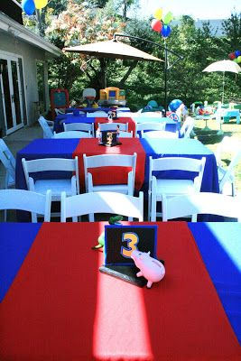 Toy Story 3 party centerpieces decor.. She has some really cute ideas in here, esp the army men and the favor bags.