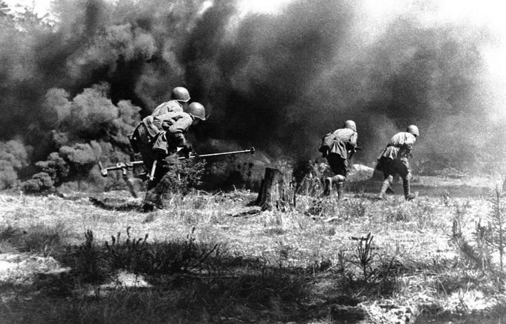 A Russian anti-tank gun crew advances towards the German positions under cover of a smoke screen, somewhere in Russia, on July 23, 1943.