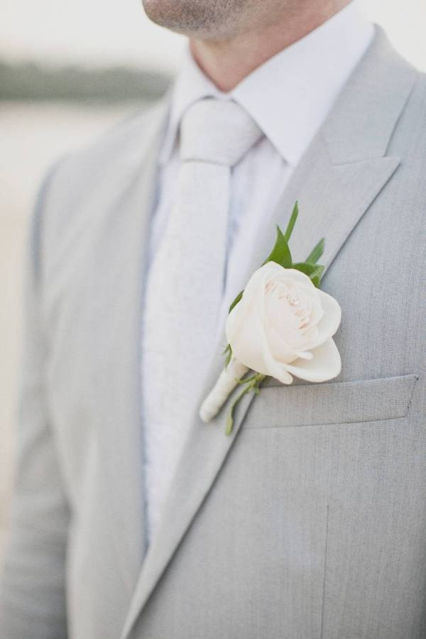Simple design button hole for groom to match up with bride's bouquet.  Groom would like a hint of colour perhaps the blush pink?