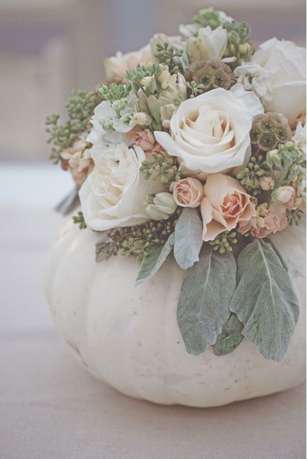 This may be one of the prettiest  Fall Centerpieces I've ever seen. Pink and white roses,  lambs ears, and Eucalyptus in a white pumpkin.  Just a note; Lambs Ears do not have a long vase life and will wilt quickly so you may want to use  Eucalyptus leaves. They also have a gray tint , a long vase life, and a nice menthol fragrance.