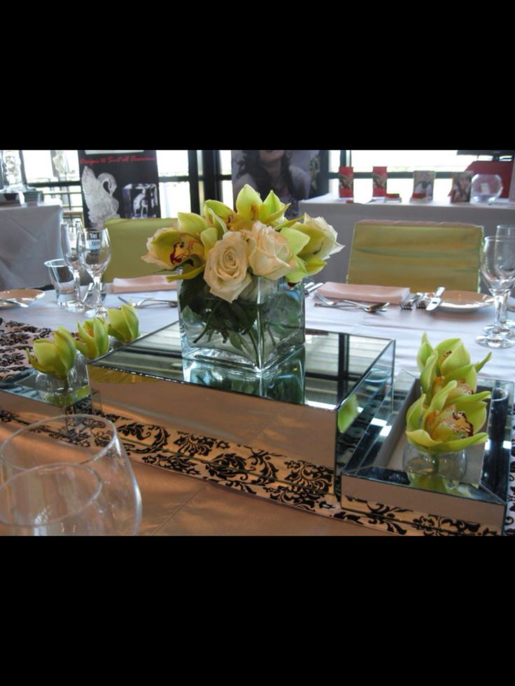 Fresh rose and green orchid on mirror boxes centrepiece by www.newminsterfunctiondesign.com