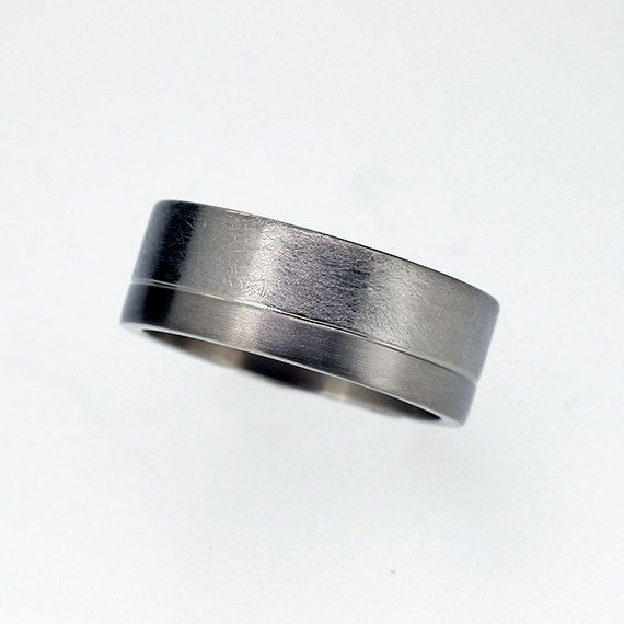 Men's white gold wedding ring with scratched and matte finish  by TorkkeliJewellery