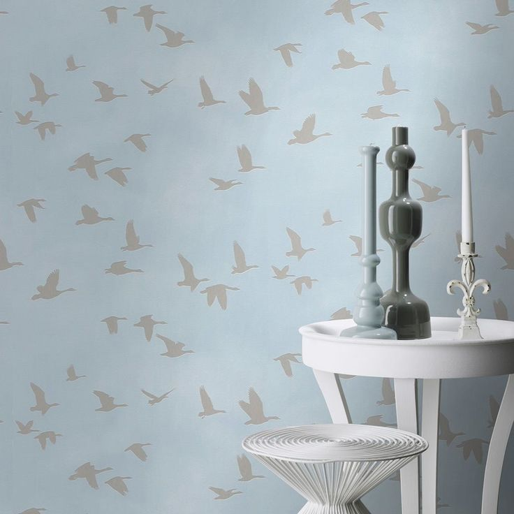 Rasch Metallic Flying Birds Wallpaper - Blue / Silver 503357 This stunning Flying Birds themed wallpaper features a flying geese design in a pale metallic silver that is embedded into soft matte paper in a beautiful sky blue shade. Easy to apply, this high quality wallpaper would look fantastic when used to decorate a whole room or to create a feature wall. A stunning birds themed wallpaper Features metallic detailing Ideal for feature walls and entire rooms 10.05m (32.9 ft) long x 53c...