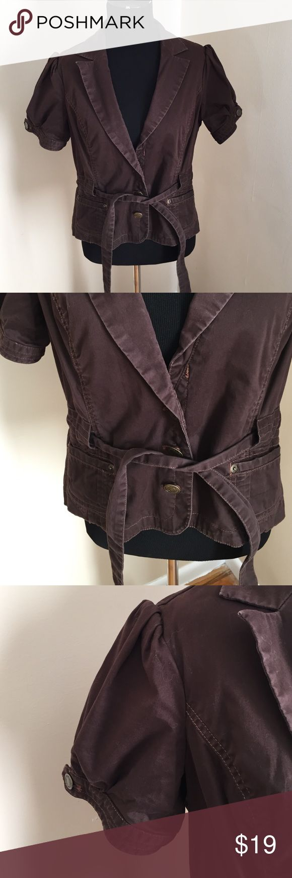 London jeans brown Distressed jacket top. M London jeans by Victoria's Secret jacket top brown distressed. it is a size 12 but fits more like an eight or 10 it is very small cut. Super cute and looks great with the tank under it can be dressed up or dressed down in very good condition and it's one of my favorites london jeans Tops