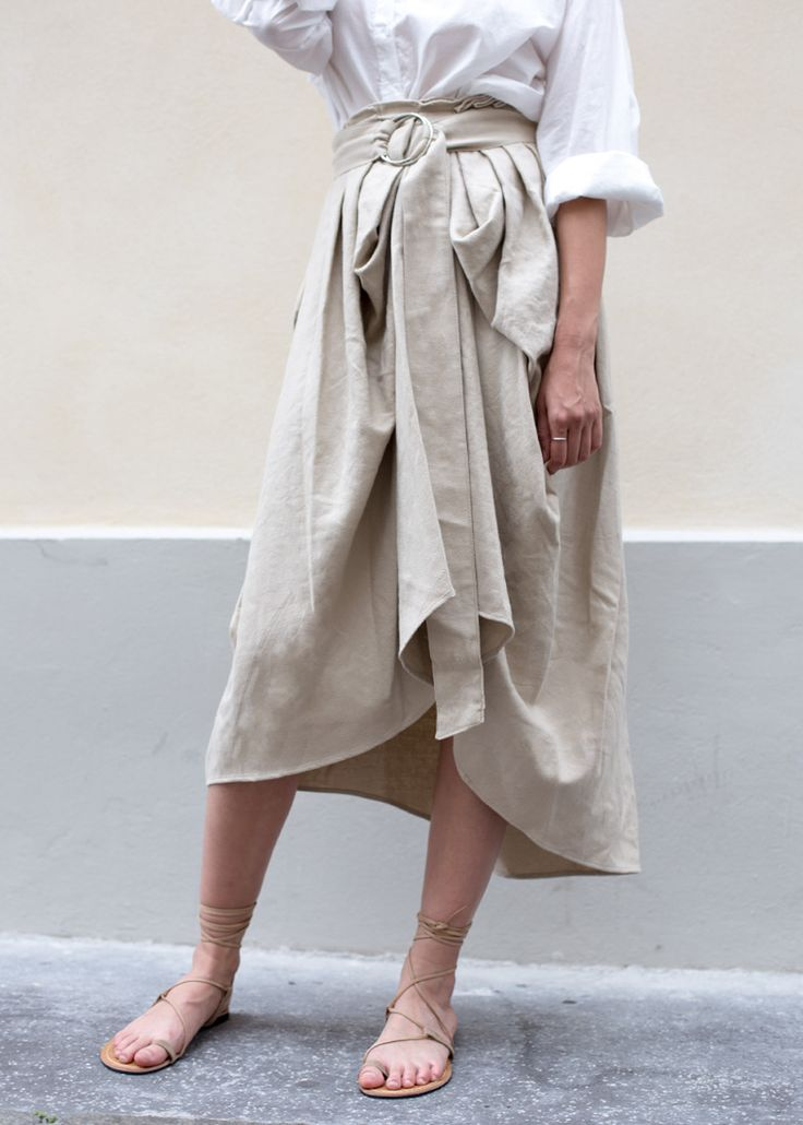 "#newarrivals #beige #draped #skirt #thefrankieshop #frankienyc #frankiegirl Mid Length, Draped Front Skirt w/Zip Back Closure. Detachable Belt 60% Linen, 40% Cotton 26"" Front Length, 35"" Back Length, 25.5"" Waist/S, 27.5"" Waist/M Dry Clean Imported"