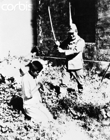 """Chinese Boy Beheaded - his only crime was being a member of a household suspected by the Japanese of aiding Chinese guerillas (the Japanese call them """"Bandits"""") ca. 1938. Corbis photo"""