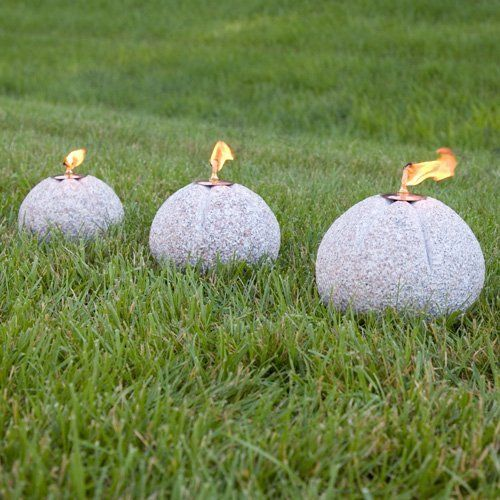 Granite Oil Lamp Set - Set of 3 - Pink Granite by Maycreek. $229.95. Adding a Granite Oil Lamp to your outdoor living space will be the perfect way to create a relaxing ambience. Enjoy a lamp individually or use a set on the top of an outdoor table. Fill the tabletop torch with citronella fuel (sold separately) to repel insects. Shown in Gray Granite. Hand-carved from natural granite. Available in three sizes: Small overall dimensions: 7-1/4 diameter x 6-1/2 H. Small lamp ho...