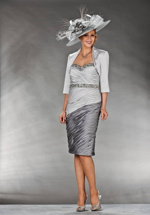 Mother Of The Bride / Groom Outfit: Knee length satin silver and grey pleated dress with a crystal detail on the waist and sweetheart neckline and a matching silver bolero