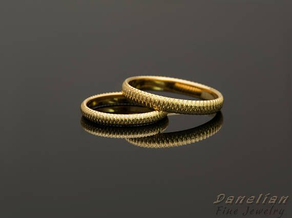 Simple his and her wedding bands, made of solid gold and textured finish. All ring sizes can be made especially for you as desired. #danelianjewelry creates fine jewelry for wedding, engagement, anniversary with any custom designs. #wedding #anniversary #couple #weddingband #coupleband #set #etsyjewelry #gold #rosegold #yellowgold #athens #worldwideshipping