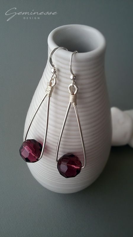 Silver plated dangle earrings with purple Czech glass bead.