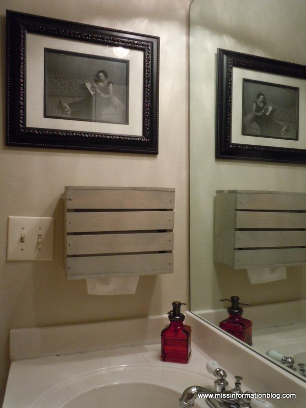 crafty way to hide paper towels in your bathroom.  Use kleenex towels inside crate.  You could dress up crate or cover for a less casual look.