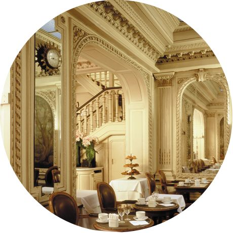 """Le salon de thé - Angelina. You can have a delicious meal in this lovely setting, or simply purchase pastries and Angelina's hot chocolate """"to go"""" and enjoy them across the street in the Tuileries Gardens. (Be sure to buy a package of their chocolate mix to take home!)"""