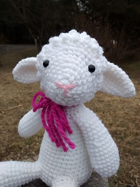 This pattern is for a sweet sheep toy, about 9 inches tall when sitting. Materials needed include medium weight yarn, G/6 - 4.00 mm crochet hook, polyester fiber filling, and either safety eyes or thread for embroidery features.
