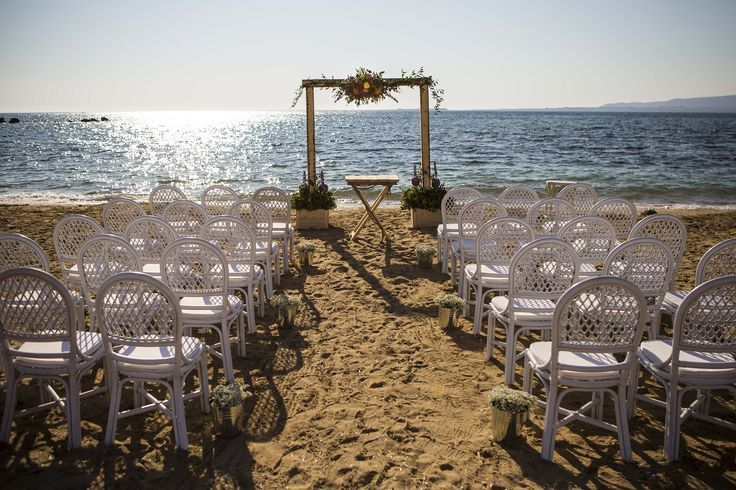 Wonderful ceremony set up - Wooden vintage flower arch - Beautiful bamboo chairs for wedding seating #beachwedding #weddingideas #weddingingreece #mythoswedding #kefallonia