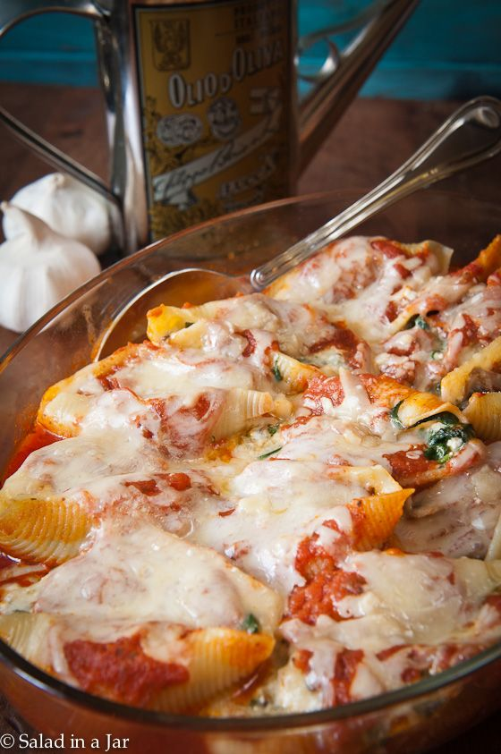 Recipe For Cheesy Spinach and Mushroom Stuffed Shells - The easiest part, of course, is eating it. With gooey cheese, flavorful spinach and mushrooms, and pasta shells bathed in your favorite marinara, who can resist?