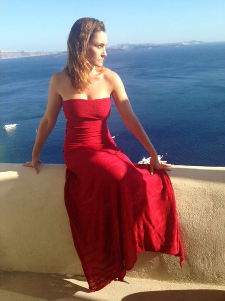 During her holidays in Santorini (Greece), gorgeous Sara Andreasson, co-founder of Michele Marie PR, wears a Nassos Ntotsikas red maxi dress and kills it!  #NassosNtotsikas #GreekDesigner #FashionDesigner #KnitYourDreams #Greece #Holidays #Santorini #MaxiDress #Santorini #RedDress #Collection