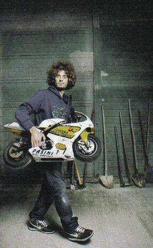 """Describe your pin"" it says...well...It's Marco Simoncelli carrying a minimoto. Does it need further explanation?"