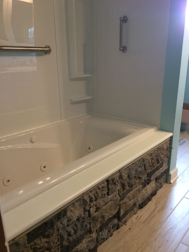 Rehabbed bathroom, new tub with Airstone wall Love it!