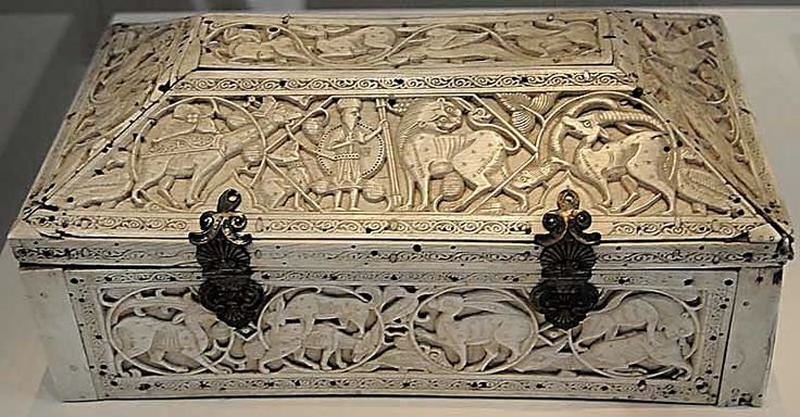 Ivory casket, Fatimid Sicily or Southern Italy, 11th-12th Centuries Rear A rectangular casket, with a desk-like lid, made of individual pieces of ivory that have been joined together. The lid is attached by two silver clasps/hinges, which were made at a later date, and the padlock has been lost. Various holes that have been bored through the casket demonstrate its chequered history and the possibility that it had an indefinite number of iron fittings. The bottom excepted, the entire box is…