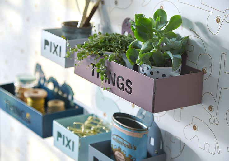 Create a multifunctional and cool storage wall with a combination of pixi and things shelves.
