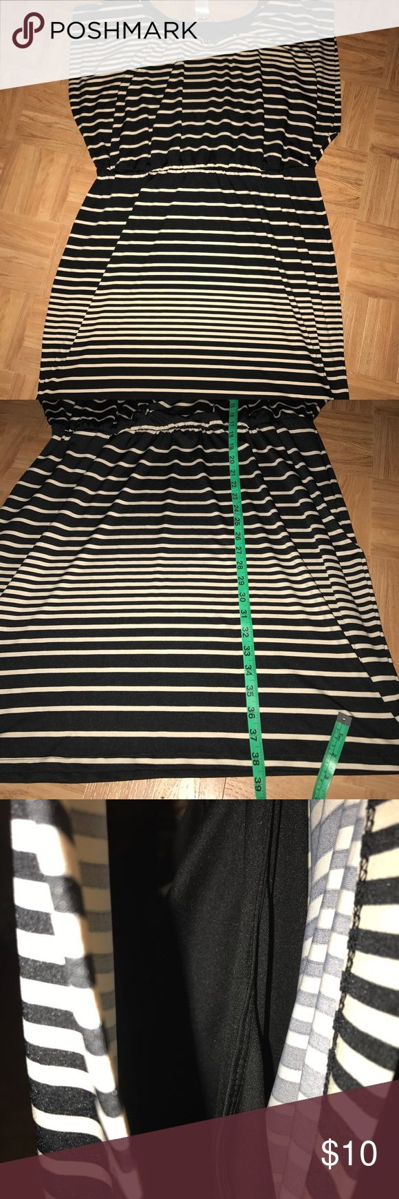 Striped plus size dress Mid length dress, elastic in waist. Came with a belt/sash but I can't find it. Fully stretched measurements in pictures, large arm holes with built it black tank. Size 2x cream/black JFW Dresses Midi