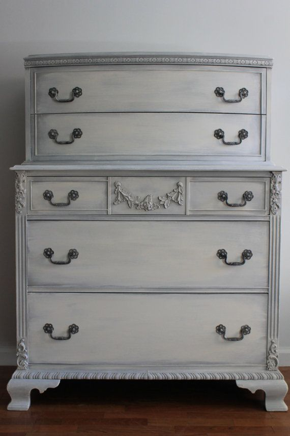 This exquisite Dresser/Chest of Drawers/Tall Dresser is done by hand in a custom mix light grey with cream highlights and accents on the hand