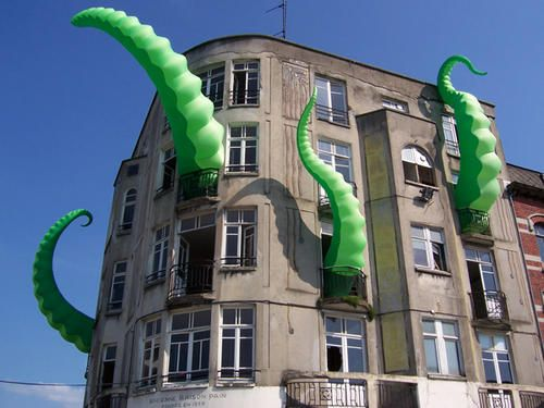 "Building festooned with inflatable tentacles - DeviantArt's FilthyLuker produced this fantastic be-tentacled building installation somewhere in France with collaborator Pedro Estrellas: ""Octo-pied Building"""