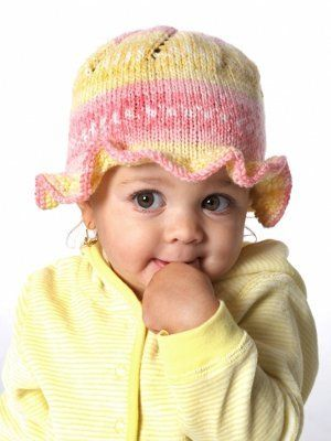 This darling baby hat knitting pattern features a sweet little ruffle around the edge to guard baby's face from the sun. Baby's Ruffle Hat is a great pattern for the novice knitter looking to whip up a baby hat with a little extra flare.