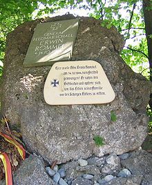 "A memorial at the site of Field Marshall Erwin Rommel's death outside of the town of Herrlingen, Baden-Württemberg, Germany (west of Ulm). Translation of the original text in German: ""On this spot Field Marshal Erwin Rommel was forced to commit suicide on October 14th, 1944. He took the cup of poison and sacrificed himself, to save the lives of his family from Hitler's henchmen."""