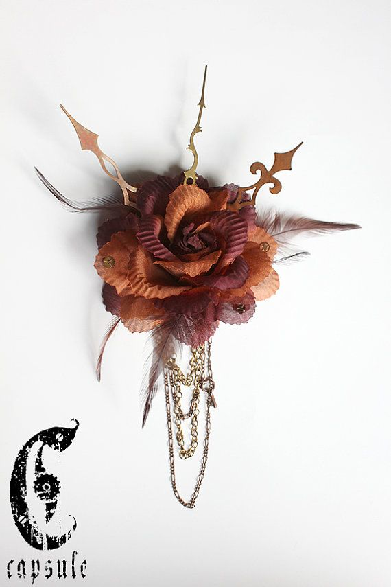 35.00$ Burnt Orange and Burgundy Steampunk Victorian Flower Hair Clip with Feather, Vintage Cogs, Gears, Golden and Copper Hands, Chains and Key.  https://www.etsy.com/ca/listing/188713616