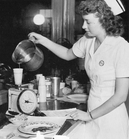 Decades ago, special diets were weighed and measured manually.  New techniques and advances in technology simplify this task today. Rex on Saint Mary's Street c. 1940.