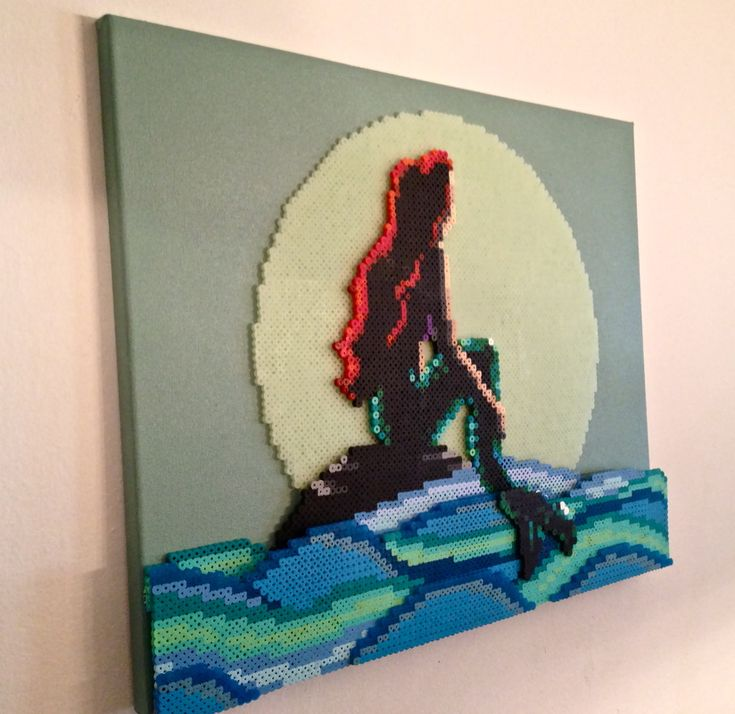 A recent commission. The Little Mermaid, Perler Fuse beads on a painted canvas. 16x20 inches.