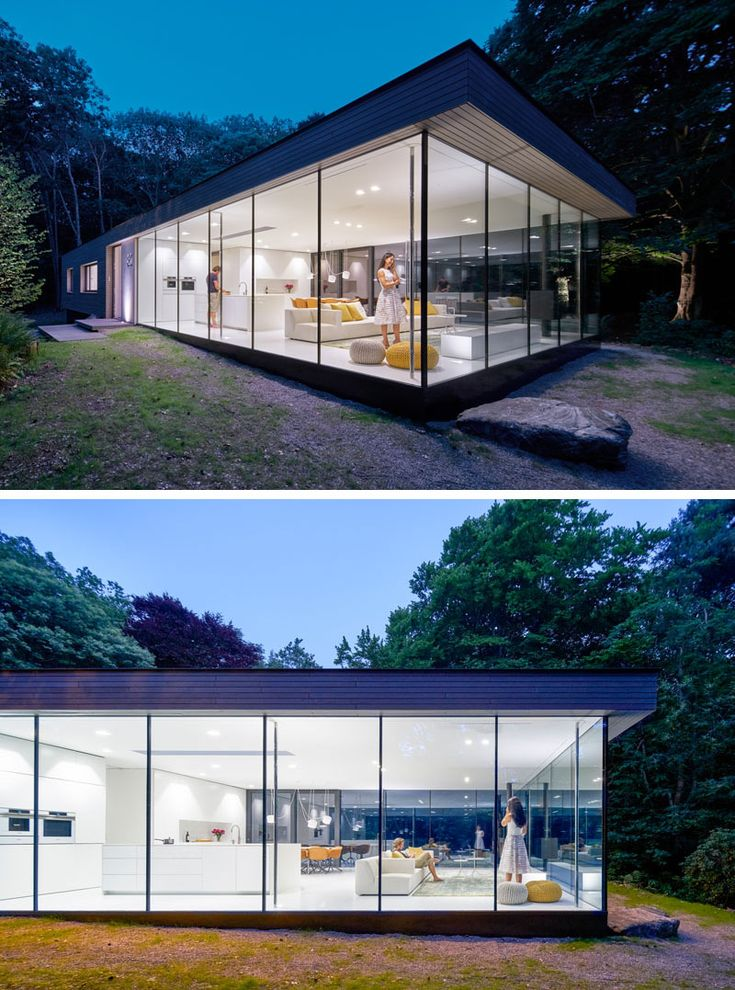 The main floor of this modern house has one end surrounded by glass on three sides, allowing the living room, kitchen and dining room to have views of the garden. #ModernHouse #Windows #GlassWalls #Architecture