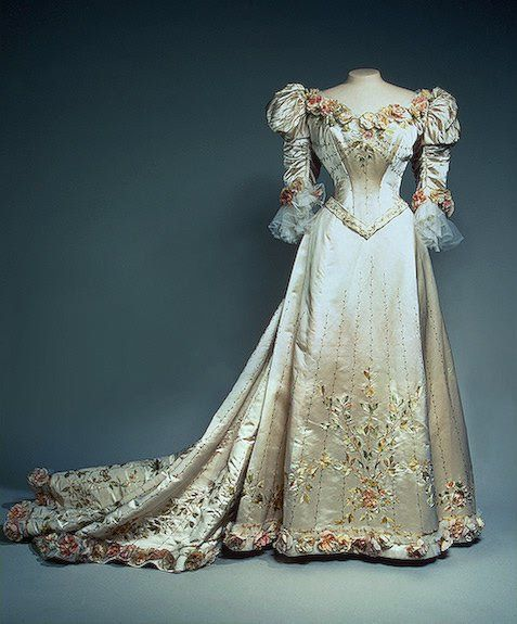 Dress of Tsarina Alexandra Romanova (1872 – 1918) - Empress consort of Russia as spouse of Nicholas II, the last Emperor of the Russian Empire. Remembered as one of the most famous royal carriers of the haemophilia disease and for her support of autocratic control over the country. Her notorious friendship with the Russian mystic Grigori Rasputin was also an important factor in her life.'