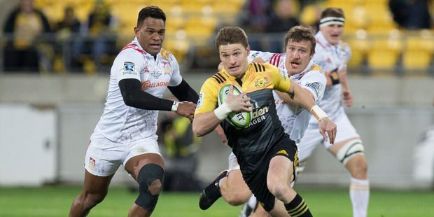 Hurricanes first five Beauden Barrett breaking the Chiefs defence to set-up his team's first try in their 2016 Invested Super Rugby semi-final. Photo - Mark Mitchell.